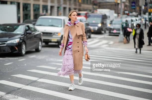 Rebecca Laurey is seen wearing brown coat pink dress hoody outside Zimmermann during New York Fashion Week Autumn Winter 2019 on February 11 2019 in...