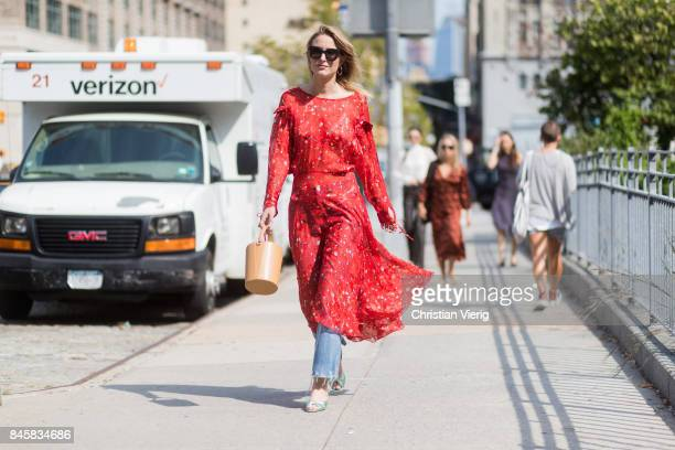 Rebecca Laurey wearing a red dress seen in the streets of Manhattan outside Zimmermann during New York Fashion Week on September 11 2017 in New York...