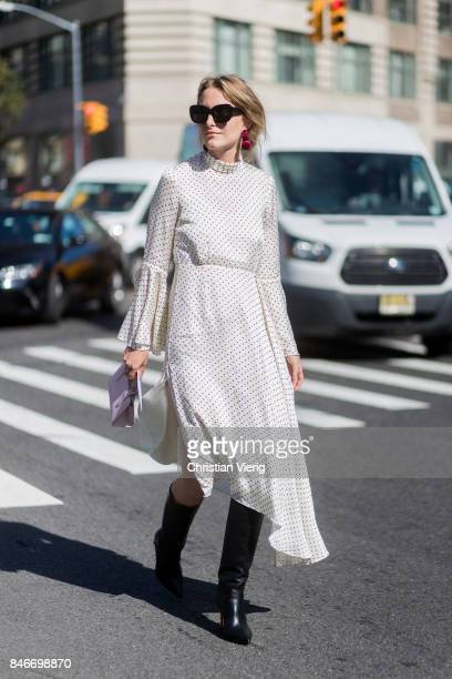Rebecca Laurey wearing a white dress seen in the streets of Manhattan outside Michael Kors during New York Fashion Week on September 13 2017 in New...