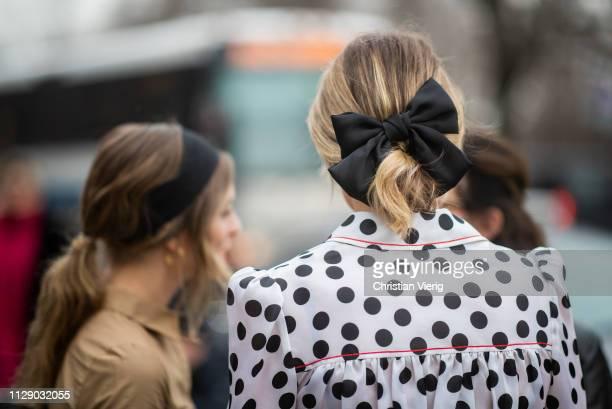 Rebecca Laurey wearing bow tie in her hair is seen outside Carolina Herrera during New York Fashion Week Autumn Winter 2019 on February 11 2019 in...
