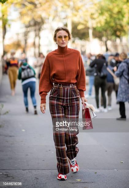 Rebecca Laurey wearing plaid pants sneaker knit is seen outside Sacai during Paris Fashion Week Womenswear Spring/Summer 2019 on October 1 2018 in...