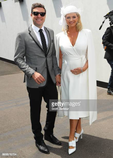 Rebecca Maddern and husband Trent Miller attend on Derby Day at Flemington Racecourse on November 4 2017 in Melbourne Australia
