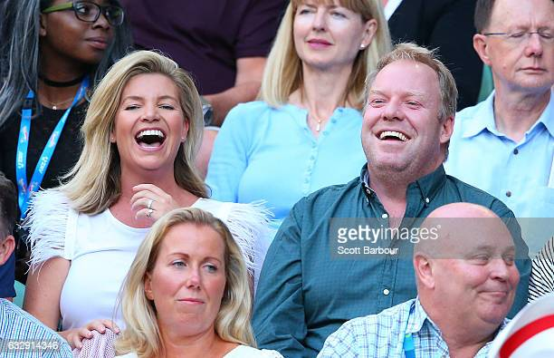 Rebecca Maddern and Peter Helliar laugh as they attend the Women's Singles Final match between Venus Williams of the United States and Serena...