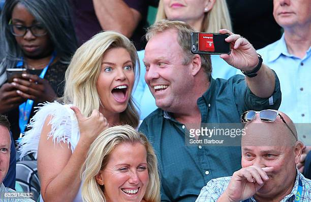 Rebecca Maddern and Peter Helliar pose for a selfie as they attend the Women's Singles Final match between Venus Williams of the United States and...
