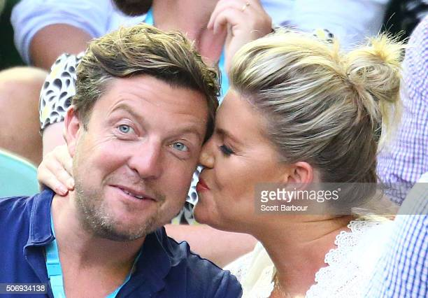 Rebecca Maddern and Trent Miller watch the quarter final match between Kei Nishikori of Japan and Novak Djokovic of Serbia during day nine of the...
