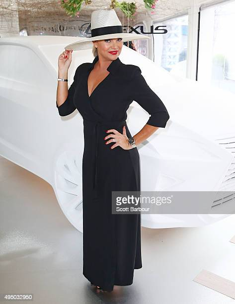 Rebecca Maddern poses at the Lexus Marquee on Derby Day at Flemington Racecourse on October 31 2015 in Melbourne Australia