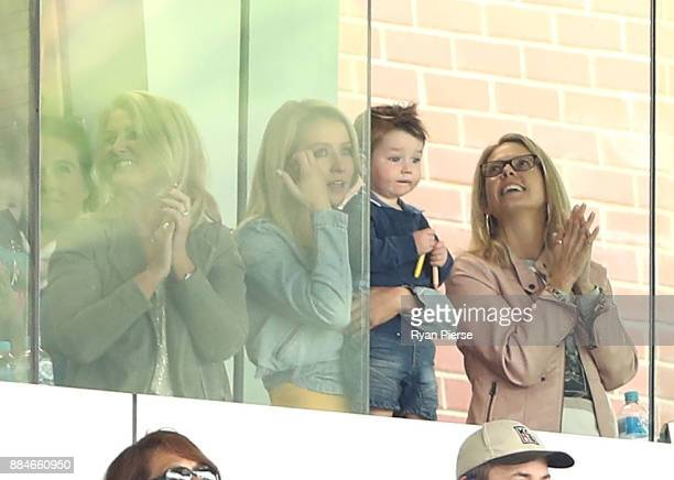 Rebecca Marsh wife of Shaun Marsh of Australia and their son Austin celebrate after Shaun Marsh of Australia reached his century during day two of...