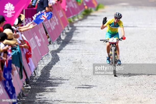 Rebecca Mcconnell of Australia waves to the crowd following the Women's Crosscountry on day eight of the Gold Coast 2018 Commonwealth Games at Nerang...