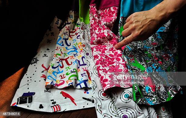 Rebecca Melsky points to a subtle Ninja character in the pattern of a dress This set of dresses include patterns with a pirate motif the Pi sign the...