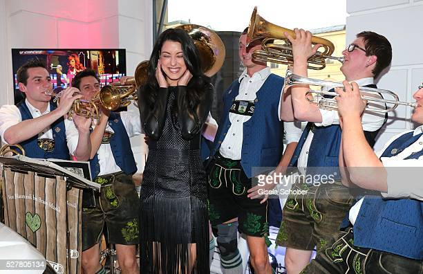 Rebecca Mir and band Tromposaund during the opening of the Jaguar Land Rover British Style Week In Munich on May 3 2016 in Munich Germany
