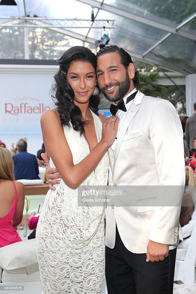 Rebecca Mir and her fiance Massimo Sinato attend the Raffaello Summer Day 2014 at Kronprinzenpalais on June 21, 2014 in Berlin, Germany.