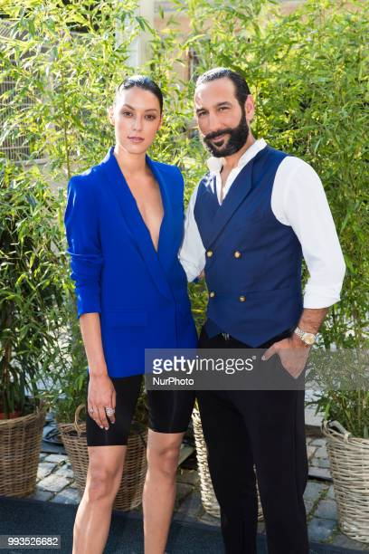 Rebecca Mir and her husband Massimo Sinato arrive to attend the Riani Fashion Show during the Mercedes Benz Fashion Week at ewerk in Berlin Germany...
