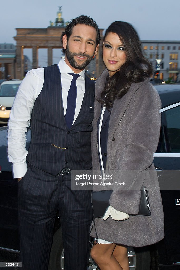 Rebecca Mir and Massimo Sinato arrive at the Marc Cain show during Mercedes-Benz Fashion Week Autumn/Winter 2014/15 at Brandenburg Gate on January 16, 2014 in Berlin, Germany.