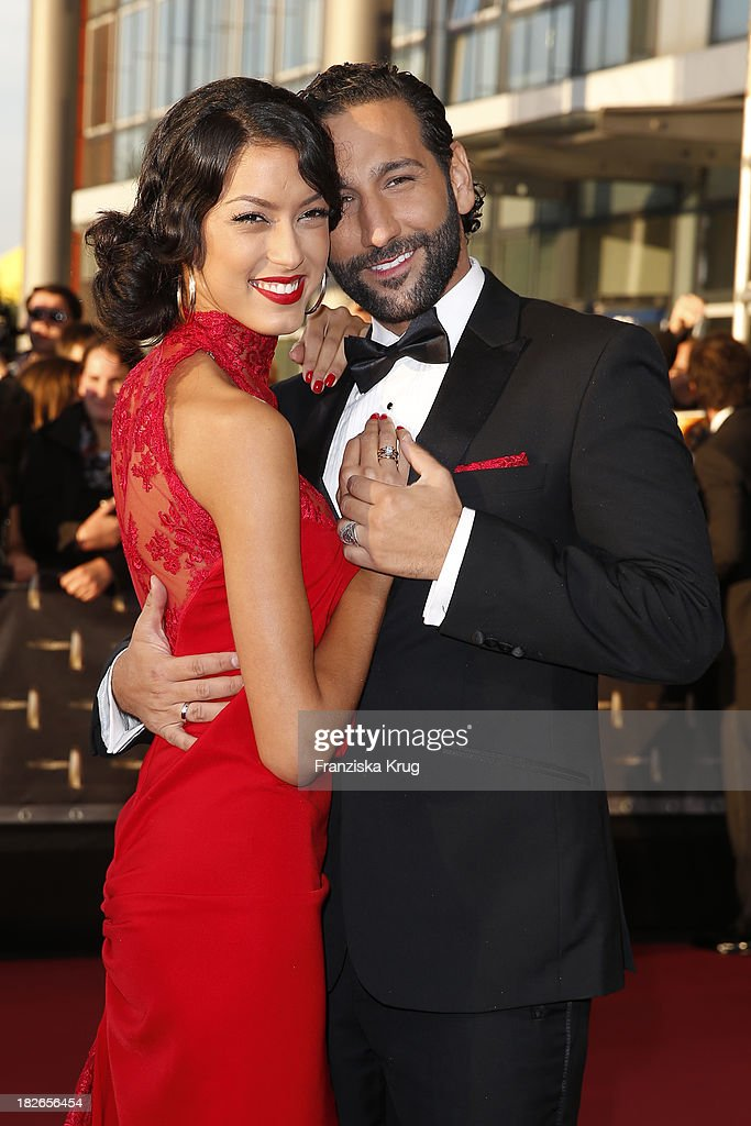 Rebecca Mir and Massimo Sinato attend the Deutscher Fernsehpreis 2013 - Red Carpet Arrivals at Coloneum on October 02, 2013 in Cologne, Germany.