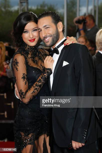 Rebecca Mir and Massimo Sinato attend the German TV Award 2012 at Coloneum on October 2 2012 in Cologne Germany