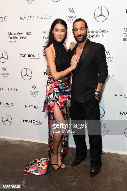 Rebecca Mir and Massimo Sinato attend the Lena Hoschek show during the Mercedes-Benz Fashion Week Berlin Spring/Summer 2018 at Kaufhaus Jandorf on...