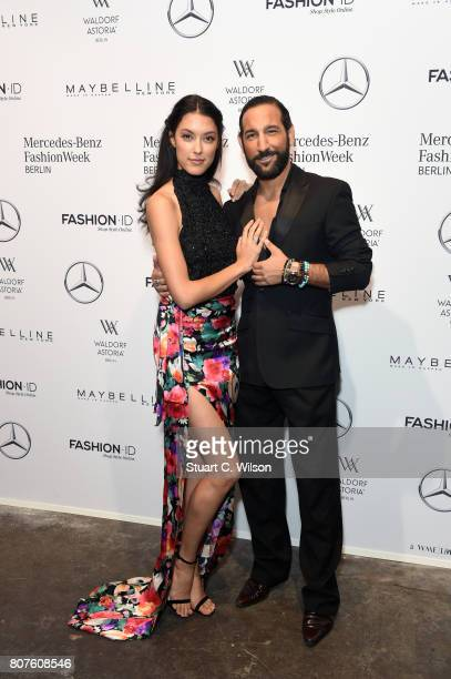 Rebecca Mir and Massimo Sinato attend the Lena Hoschek show during the MercedesBenz Fashion Week Berlin Spring/Summer 2018 at Kaufhaus Jandorf on...