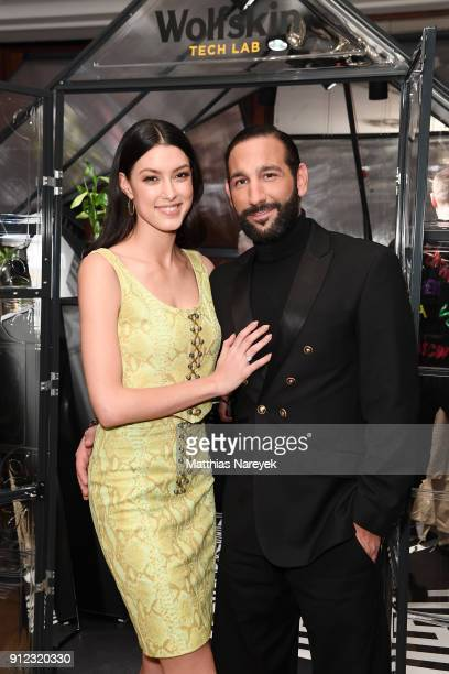 Rebecca Mir and Massimo Sinato attend the Wolfskin Tech Lab x Gianni Versace retrospective opening event at Kronprinzenpalais on January 30 2018 in...
