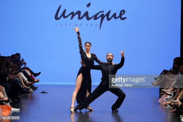 Rebecca Mir and Massimo Sinato dance on the runway at the Unique show during Platform Fashion July 2017 at Areal Boehler on July 22 2017 in...