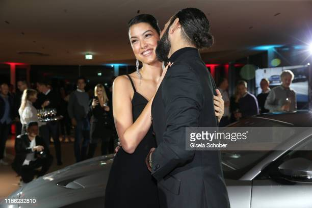 Rebecca Mir and Massimo Sinato during the Jaguar F-Type world premiere at Jaguar Land Rover Statement Site on December 2, 2019 in Munich, Germany.