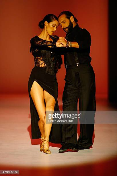 Rebecca Mir and Massimo Sinato perform on the runway at the Riani show during the MercedesBenz Fashion Week Berlin Spring/Summer 2016 at Brandenburg...