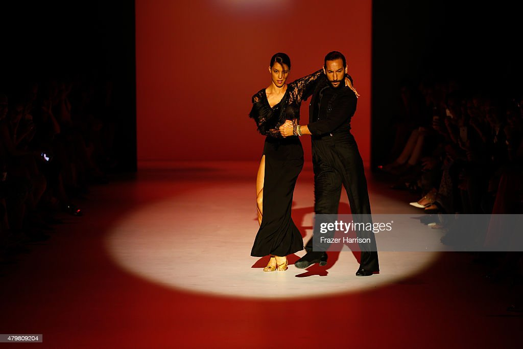 Rebecca Mir and Massimo Sinato perform on the runway at the Riani show during the Mercedes-Benz Fashion Week Berlin Spring/Summer 2016 at Brandenburg Gate on July 7, 2015 in Berlin, Germany.