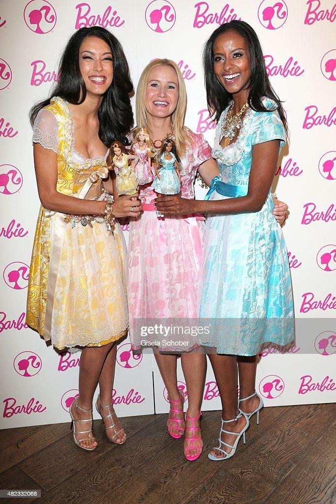 Rebecca Mir, Dirndl Designer Ophelia Blaimer, Sara Nuru wearing a dirndl by Ophelia Blaimer during the Barbie Pre Pink Wiesn Brunch at Kaefer Stuben on July 30, 2015 in Munich, Germany.