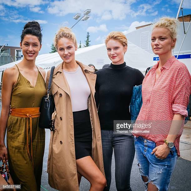 Rebecca Mir Elena Carriere Kim Hnizdo and Franziska Knuppe pose for photographs backstage ahead the Anja Gockel show during the MercedesBenz Fashion...