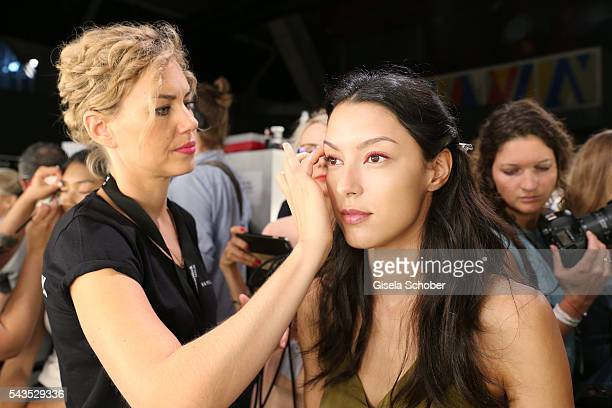 Rebecca Mir gets prepared backstage ahead of the Minx by Eva Lutz show during the MercedesBenz Fashion Week Berlin Spring/Summer 2017 at Erika Hess...