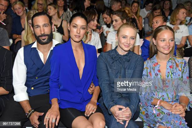 Rebecca Mir her husband Massimo Sinato Anna Maria Muehe and Sonja Gerhardt attend the Riani show during the Berlin Fashion Week Spring/Summer 2019 at...