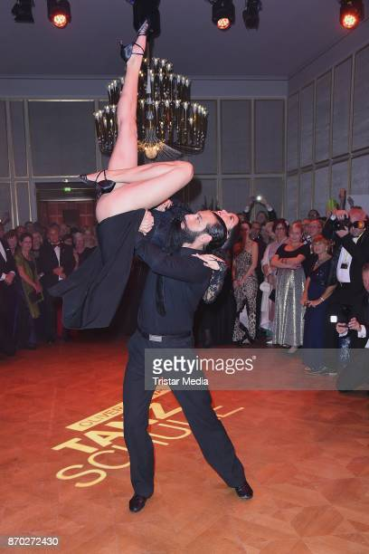 Rebecca Mir in a dress of Boss Couture and her husband Massimo Sinato perform the Leipzig Opera Ball on November 4 2017 in Leipzig Germany