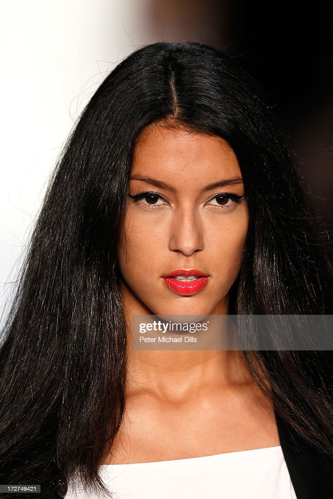 Rebecca Mir walks the runway at the Laurel Show during the Mercedes-Benz Fashion Week Spring/Summer 2014 at Brandenburg Gate on July 4, 2013 in Berlin, Germany.
