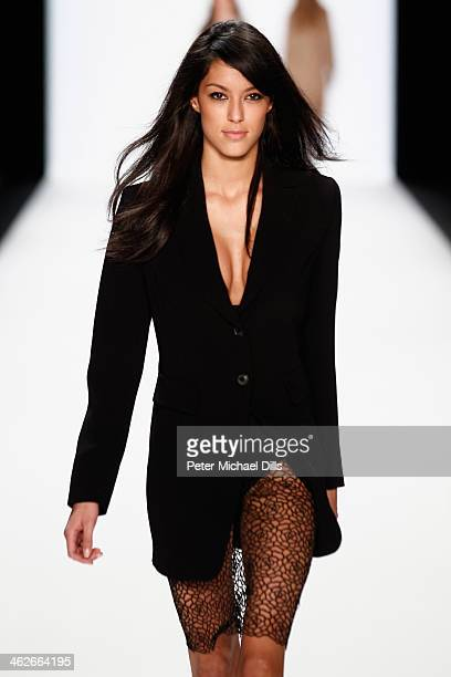 Rebecca Mir walks the runway at the Riani show during MercedesBenz Fashion Week Autumn/Winter 2014/15 at Brandenburg Gate on January 14 2014 in...