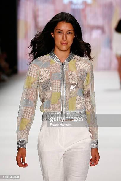 Rebecca Mir walks the runway at the Riani show during the MercedesBenz Fashion Week Berlin Spring/Summer 2017 at Erika Hess Eisstadion on June 28...