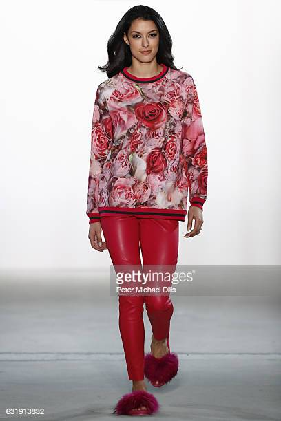 Rebecca Mir walks the runway at the Riani show during the Mercedes-Benz Fashion Week Berlin A/W 2017 at Kaufhaus Jandorf on January 17, 2017 in...
