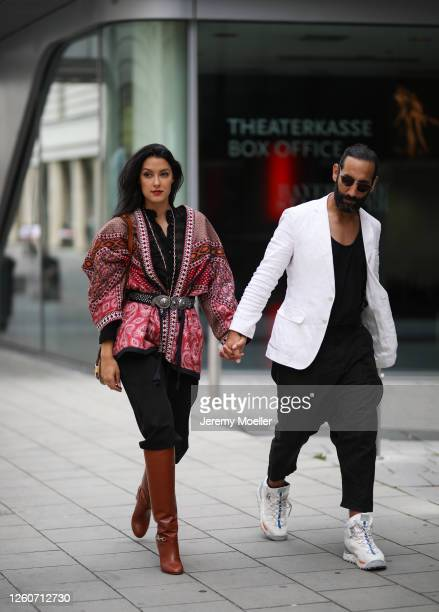 Rebecca Mir wearing a complete Etro look and bag and Massimo Sinato on July 21, 2020 in Munich, Germany.