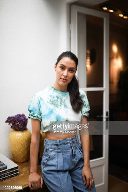 Rebecca Mir wearing a Drykorn tie dye shirt and Levis jeans on May 13 2020 in Munich Germany