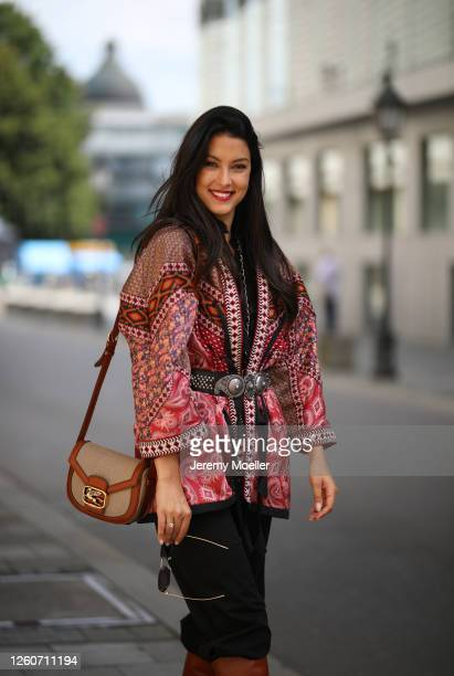 Rebecca Mir wearing complete Etro look and bag on July 21, 2020 in Munich, Germany.