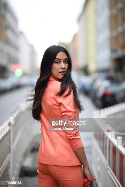 Rebecca Mir wearing Drykorn suit and Furla bag on May 13 2020 in Munich Germany
