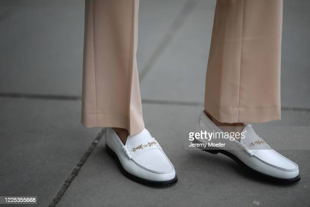 Rebecca Mir wearing Drykorn suit and Jimmy Choo loafer on May 13 2020 in Munich Germany