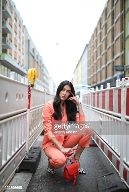 Rebecca Mir wearing Drykorn suit Jimmy Choo heels and Furla bag on May 13 2020 in Munich Germany