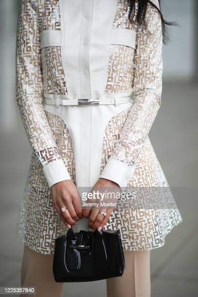 Rebecca Mir wearing Drykorn suit Longchamp rain coat and bag on May 13 2020 in Munich Germany