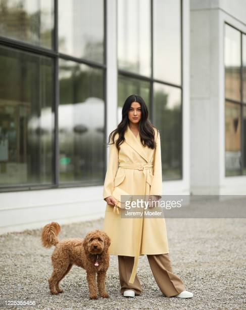 Rebecca Mir wearing Furla bag Max Mara pants Sportmax coat and Jimmy Choo sneaker on May 13 2020 in Munich Germany