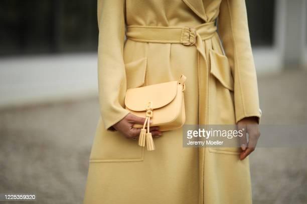 Rebecca Mir wearing Furla bag Sportmax coat on May 13 2020 in Munich Germany