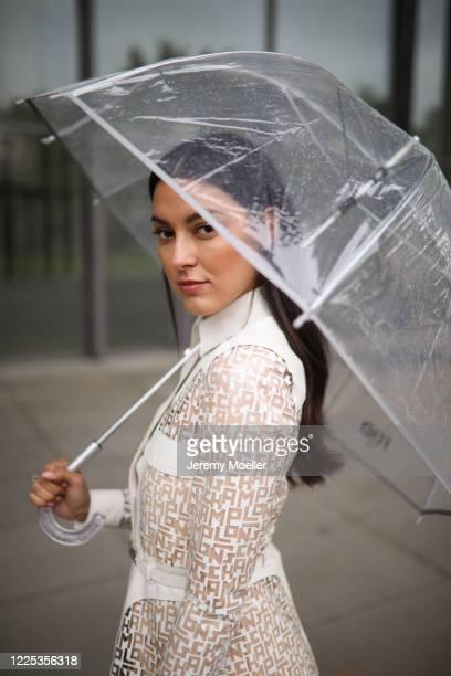 Rebecca Mir wearing Longchamp rain coat and bag on May 13 2020 in Munich Germany