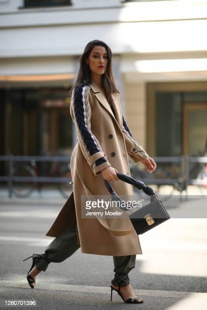 Rebecca Mir wearing Miu Miu bag, Max Mara heels and coat and Sportmax pants on July 21, 2020 in Munich, Germany.