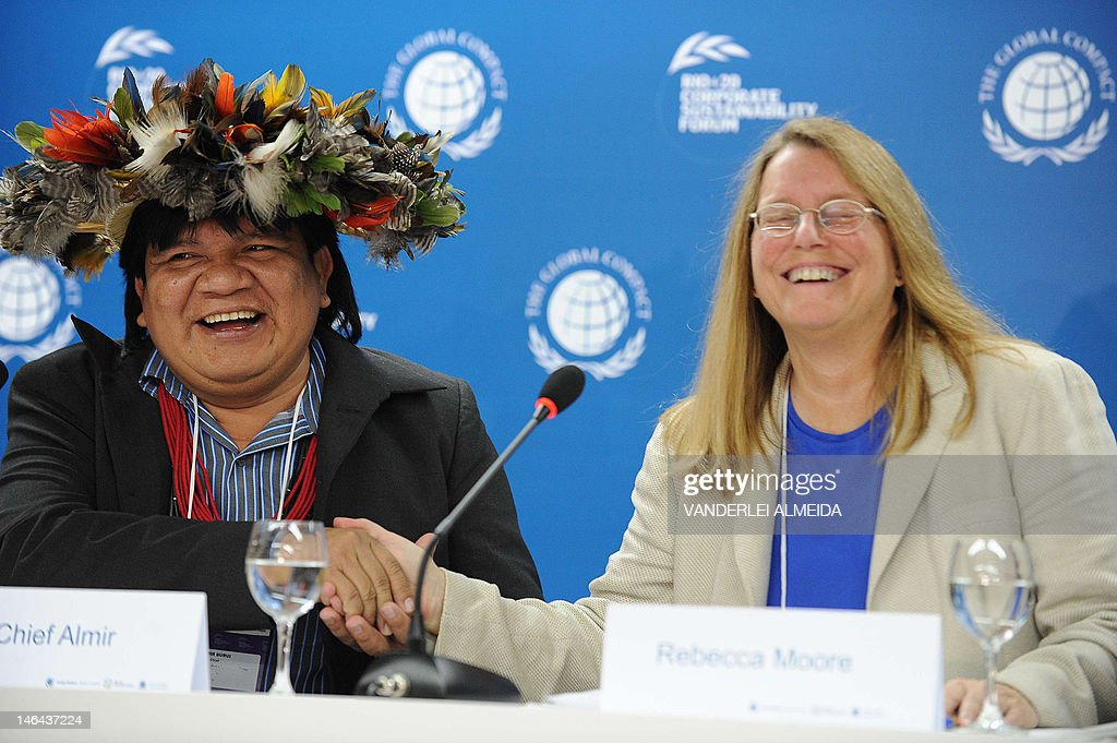 Rebecca Moore (R), Engineering Manager of Google Earth Engine and Earth Outreach, and Brazilian Surui tribe Chief Almir smiles during press conference in Rio de Janeiro June 16, 2012. Moore announced the creation of a Google culture map for the Surui tribe in Amazonia. The UN conference, which marks the 20th anniversary of the Earth Summit -- a landmark 1992 gathering that opened the debate on the future of the planet and its resources -- is the largest ever organized, with 50,000 delegates.