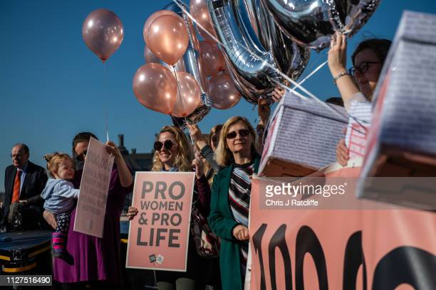 Rebecca Morgan and her daughter Helen join protesters supporting Northern Ireland's abortion laws at Parliament Square on February 26 2019 in London...
