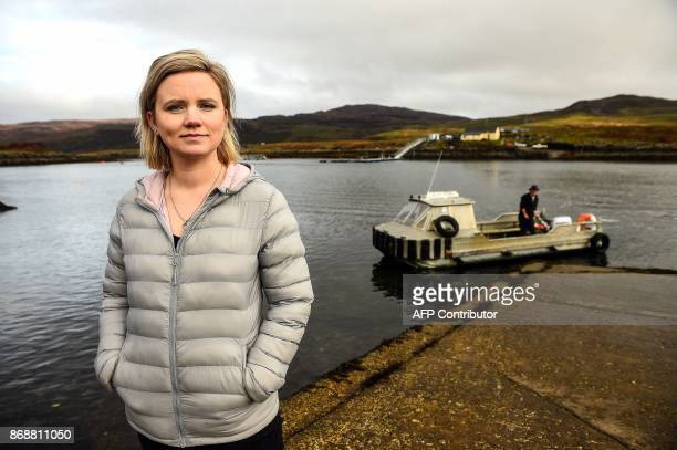 Rebecca Munro one of the six residents of the Isle of Ulva off Scotland's west coast poses by the shore on October 20 2017 When tycoons in...