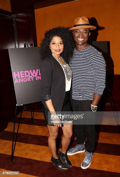 Rebecca Naomi Jones and Taye Diggs during the photo call for Taye Diggs return to Broadway starring in 'Hedwig and the Angry Inch' at The Lamb's Club...